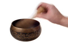 Tibetan Bronze Singing Bowl in Use. Tibetan Singing Bowl Isolated With Heand in Motion Stock Photography
