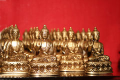 Tibetan Buddha Collection for Prayer. Golden Buddha's in a collection and arranged  display in Tibetan Buddhist Monastery and Temple  in Dalai Lama's Palace in Stock Photography