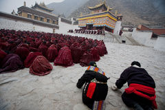 Tibetan Buddhism. Living Buddha mobilize monks sat on the floor, mouth silent song Diamond Sutra, by good fortune, deep and low voice, distant, lingering Royalty Free Stock Photos