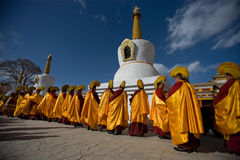 Tibetan Buddhism. Under the White Tower chanting monks to pray Royalty Free Stock Images
