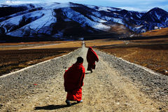 Tibetan Buddhism. Two small Lama, to participate in temple ritual activity, live from the temple back to the place to go Stock Photography