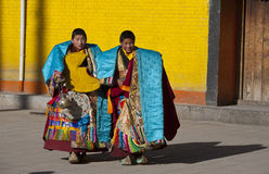 Tibetan Buddhism. Temple ceremonies held at the West warehouse activities, both dressed in festive costumes small Lama, preparing to go to participate in ritual Stock Image