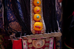 Tibetan Buddhism. Tibetan girls especially like to wear red coral, jade, agate, turquoise necklace made of mixed clothing, and some accompanied by a Stock Image