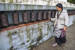 Tibetan Buddhism. JIRI, NEPAL – CIRCA OCTOBER 2013: prayer wheel used in Tibetan Buddhism to the rotational axis of the cylinder inscribed with mantras surface Stock Photography