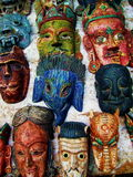 Tibetan Buddhist Deity Masks. Colorful evocative Tibetan Buddhist and Hindu deity masks worn in ritual performances, shown here on display at a street vendor in Stock Photography