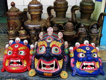 Tibetan Buddhist Deity Masks. Colorful evocative Tibetan Buddhist deity masks worn in ritual performances called cham shown here on display at a street vendor in Stock Photos