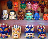Tibetan Buddhist Deity Masks. Colorful evocative Tibetan Buddhist deity masks worn in ritual performances, shown here on display at a street vendor in Boudhanath Royalty Free Stock Images