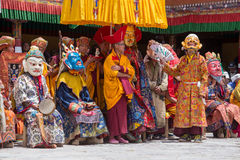Tibetan Buddhist lamas in the mystical masks perform a ritual Tsam dance . Hemis monastery, Ladakh, India Royalty Free Stock Photos