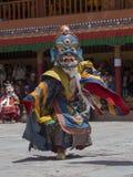 Tibetan Buddhist lamas in the mystical masks perform a ritual Tsam dance . Hemis monastery, Ladakh, India Royalty Free Stock Photo