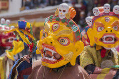 Tibetan Buddhist lamas in the mystical masks perform a ritual Tsam dance . Hemis monastery, Ladakh, India Stock Images