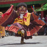 Tibetan Buddhist lamas in the mystical masks perform a ritual Tsam dance . Hemis monastery, Ladakh, India Stock Photo