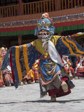 Tibetan Buddhist lamas in the mystical masks perform a ritual Tsam dance . Hemis monastery, Ladakh, India Royalty Free Stock Photo