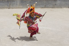 Tibetan Buddhist lamas perform a ritual dance in the monastery of Lamayuru, Ladakh, India Royalty Free Stock Image