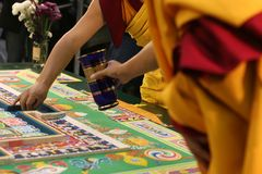 Tibetan Buddhist mandala. Tibetan Buddhist monks create a sand painting mandala Royalty Free Stock Photos