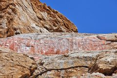 Tibetan Buddhist mantras on the rock Stock Photography