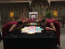 Tibetan Buddhist Monks Creating Sand Mandala Royalty Free Stock Photography