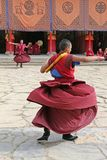 Tibetan buddhist monks dancing at a monastary in Gansu province, China Royalty Free Stock Image