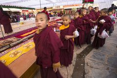 Tibetan Buddhist monks near stupa Boudhanath during festive Puja Stock Image