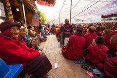 Tibetan Buddhist monks near stupa Boudhanath during festive Puja Stock Photography