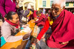 Tibetan Buddhist monks near stupa Boudhanath during festive Puja Stock Photos