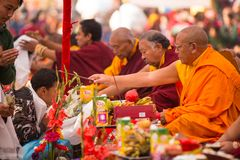 Tibetan Buddhist monks near stupa Boudhanath during festive Puja Stock Images