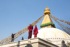 Tibetan Buddhist monks near stupa Boudhanath during festive Puja Royalty Free Stock Photos