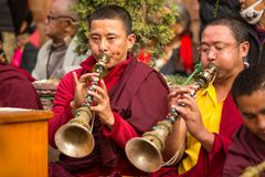 Tibetan Buddhist monks near stupa Boudhanath during festive Puja Royalty Free Stock Photography
