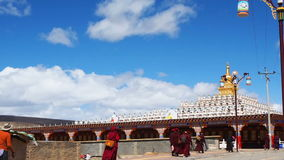 Tibetan buddhist monks and nuns walking at the pagodas in Yarchen Gar Monastery stock video