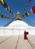 Tibetan Buddhist monks walking around Boudhanath stupa during festival Royalty Free Stock Images