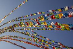 A Tibetan Buddhist multicolored prayer flags on the background of a clear blue sky stock photography
