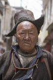 Tibetan Buddhist old man on the streets in Leh. Ladakh, North India. LEH, INDIA - JUNE 29, 2015 : Unidentified tibetan buddhist old man on the streets in Ladakh Stock Photography