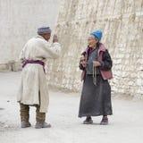 Tibetan Buddhist old woman and man in the monastery of Lamayuru, Ladakh, India Stock Photography