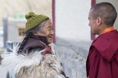 Tibetan Buddhist old woman and monk in the monastery of Lamayuru, Ladakh, India Stock Images