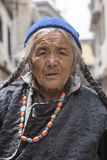 Tibetan Buddhist old woman on the streets in Leh. Ladakh, North India Royalty Free Stock Photo