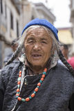 Tibetan Buddhist old woman on the streets in Leh. Ladakh, North India Stock Image