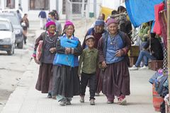 Tibetan Buddhist old women and boy on the streets in Leh. Ladakh, North India Royalty Free Stock Image