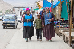 Tibetan Buddhist old women and boy on the streets in Leh. Ladakh, North India Royalty Free Stock Photo