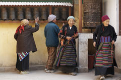 Tibetan Buddhist Pilgrims. Spin prayer wheels at Boudhanath Stupa, Kathmandu< nepal Royalty Free Stock Images