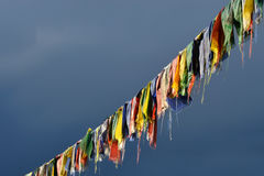 Tibetan Buddhist prayer flags on the background of stormy blue sky, Tibet. Royalty Free Stock Photography