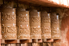 Tibetan Buddhist Prayer Wheels. In a row Stock Images