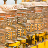 Tibetan Buddhist prayer wheels at Boudhanath stupa in Kathmandu Stock Photos
