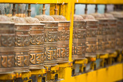 Tibetan Buddhist prayer wheels at Boudhanath stupa in Nepal. Stock Photo