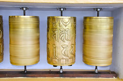 Tibetan Buddhist prayer  wheels in McLeod Ganj temple, India Stock Photos