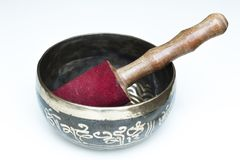 Tibetan buddhist singing bowl with pestle close up. Black metal royalty free stock images