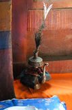 Tibetan Buddhist still life - water vessel. Hemis gompa, Ladakh, India. royalty free stock images