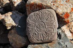 Tibetan Buddhist stone with mantras Royalty Free Stock Photo