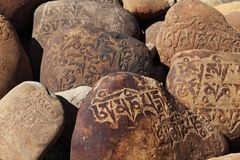 Tibetan Buddhist stone with mantras Royalty Free Stock Photos