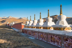 Tibetan Buddhist stupas are shine under the sunset light Royalty Free Stock Photography