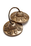 Tibetan Buddhist tingsha cymbals isolated Stock Photos