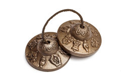 Tibetan Buddhist tingsha cymbals isolated Stock Photography
